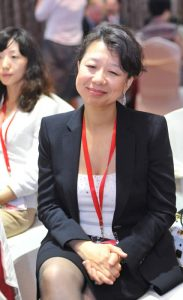Above: Kingchem COO Lillian Wu enjoys the performances at the July 26th event.