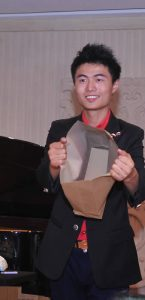 Above: A magician entertained the crowd at the June 26th Shanghai event.