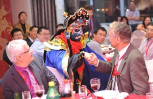 Above: The Bian Lian dancer (see below for more information) interacted with guests at the Shanghai dinner.